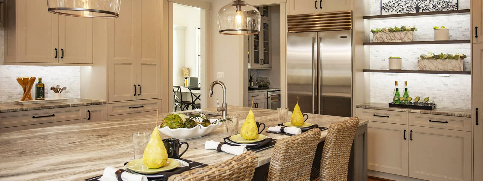 Modern kitchen island set with yellow pears.